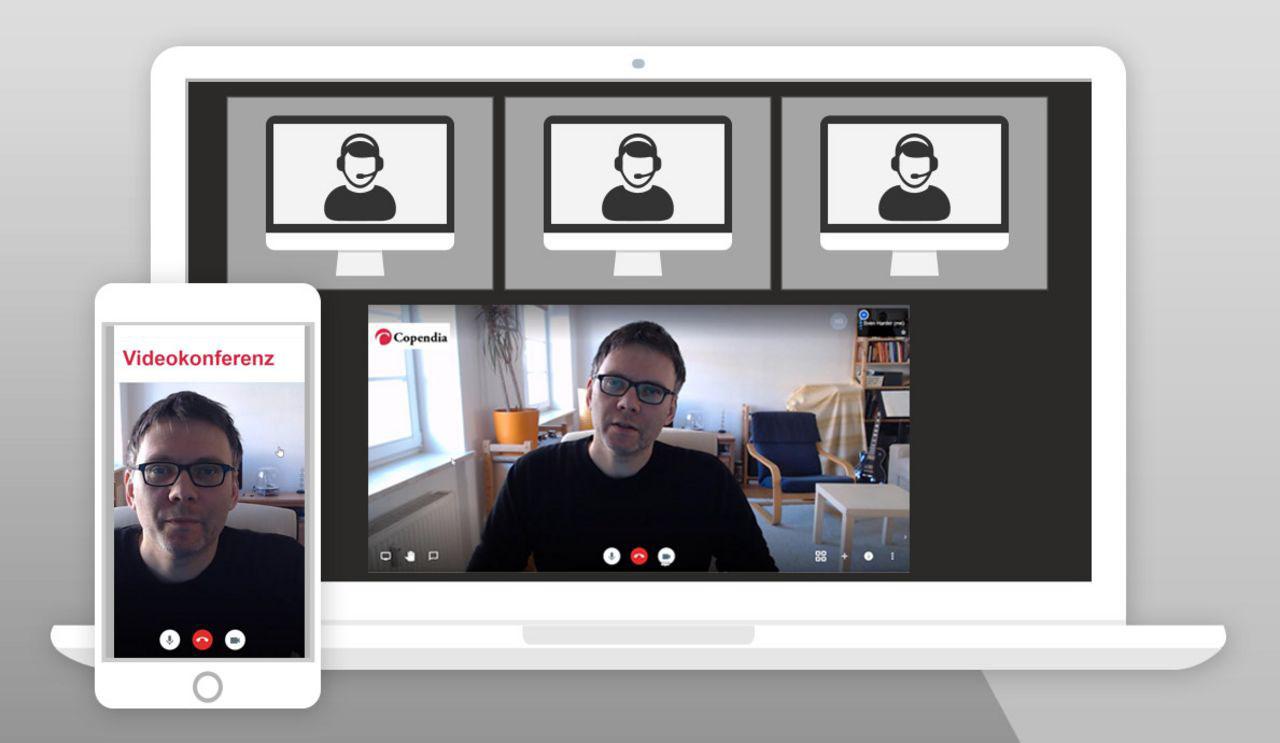 Auf diesem Bild ist ein Notebook und ein Handy mit dem Copendia Videokonferenzsystem zu sehen